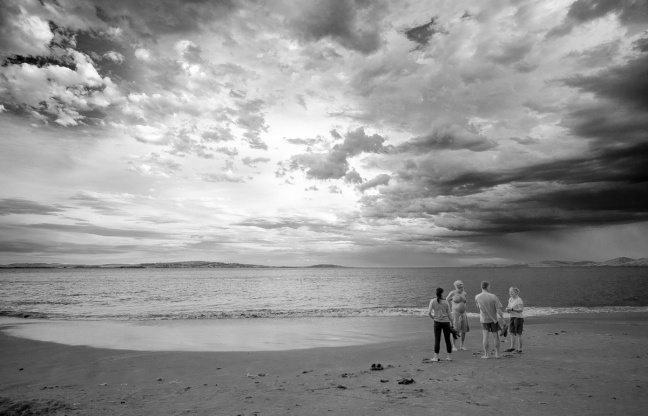 Emily, Peter, Lorne, and Cawley at Hobart Beach before a storm.